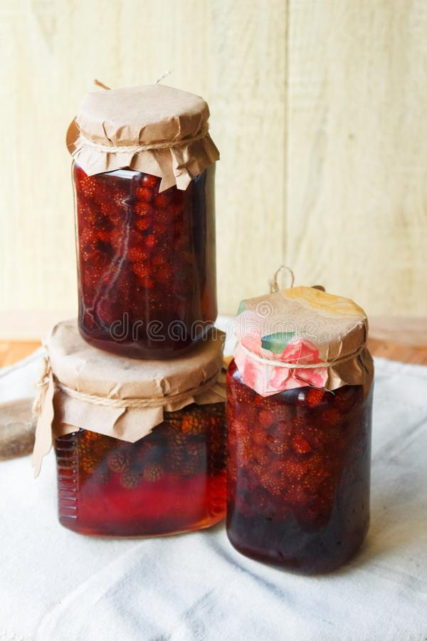 Strawberry jam with a blank label stock images