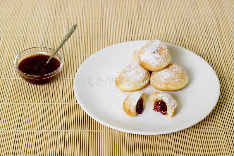 Strawberry jam donuts royalty free stock photography