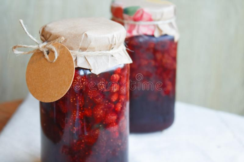 Strawberry jam with a blank label royalty free stock photo