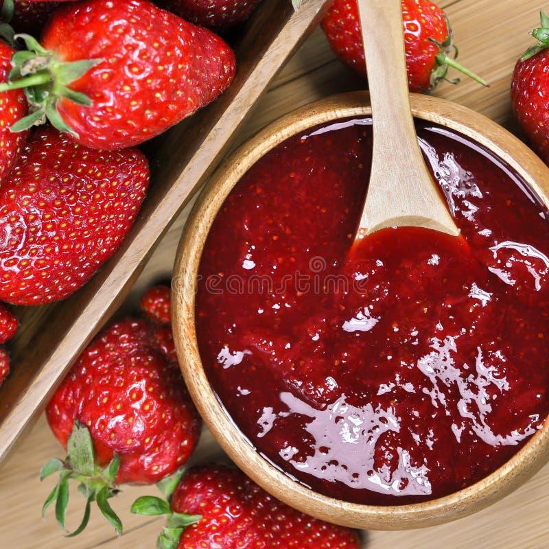 Strawberry jam or marmalade. Homemade strawberry jam or marmalade with fresh strawberries in the backgoround stock photos