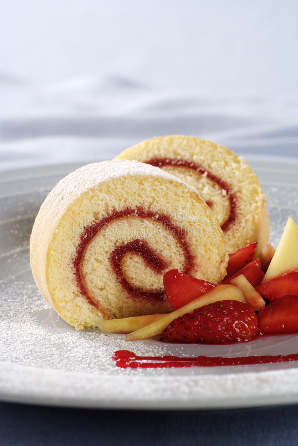 Strawberry Jam Swiss Roll. Two slices of strawberry jam Swiss roll stock photo