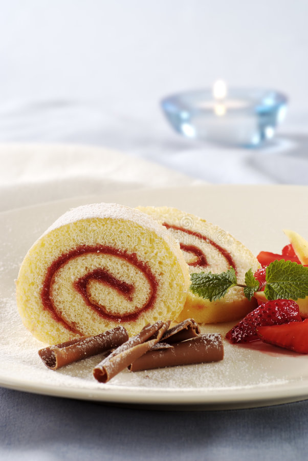 Strawberry Jam Swiss Roll. Two slices of strawberry jam Swiss roll royalty free stock photography
