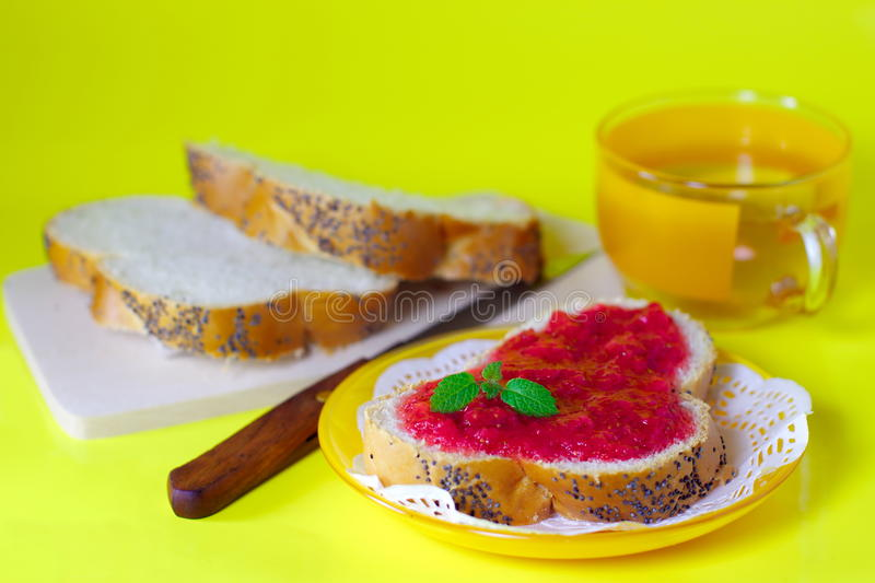 Strawberry jam on a white bread tea cup stock images