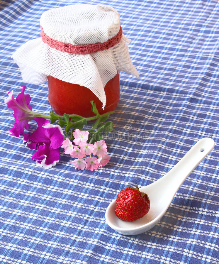 Strawberry and jar of the strawberry cooking stock image