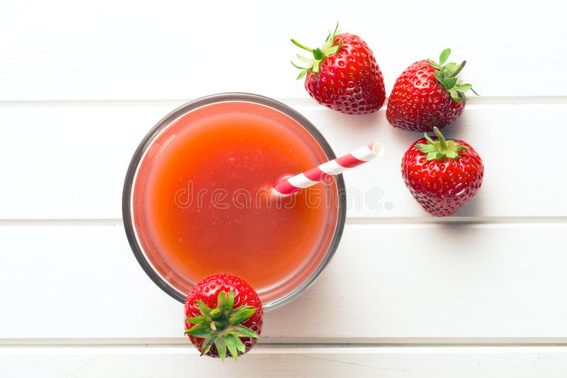 Strawberry juice in glass stock image