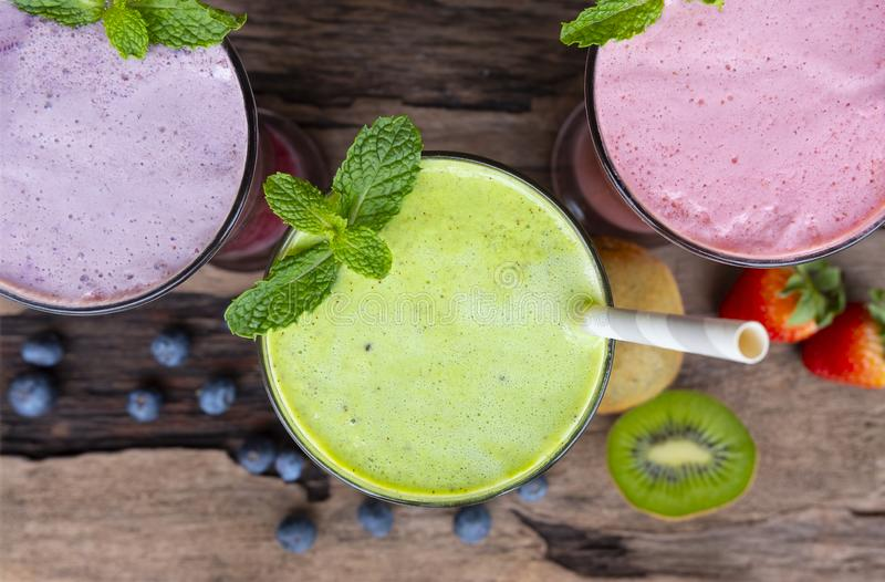 Strawberry kiwi and blueberry smoothies fruit for slimming on wooden backgroundfrom the top view. stock photo