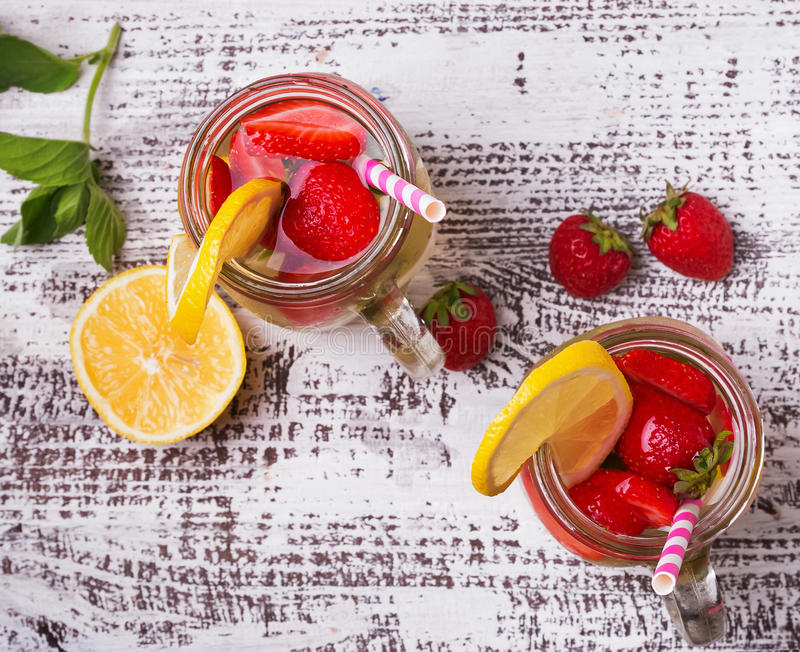 Strawberry and lemon detox water in glass jars royalty free stock image