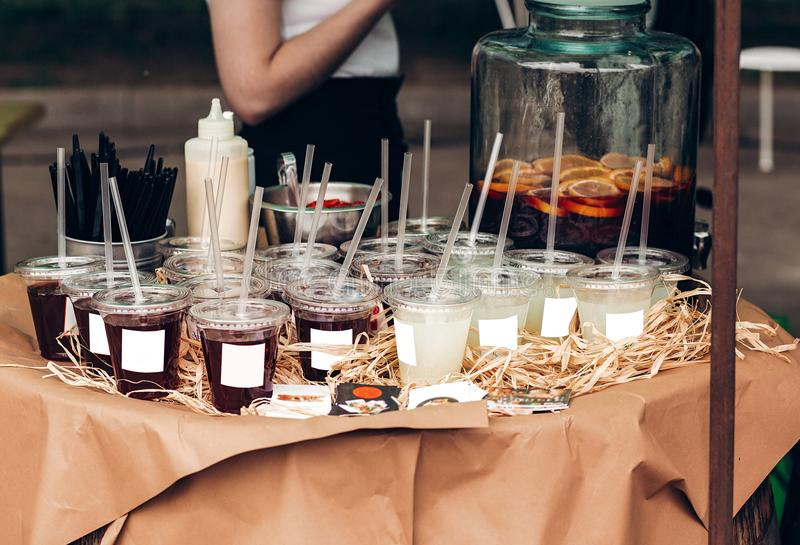 Strawberry and lime lemonade, space for text. street food festival. drink bar at reception, catering outdoors. summer picnic. col. Orful drinks in plastic cups stock photo