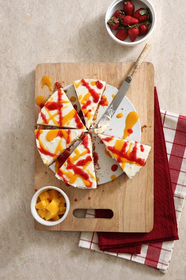 Strawberry mango cake. On wooden board royalty free stock photos