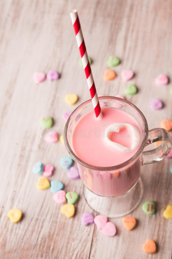 Strawberry milk and conversation hearts stock images