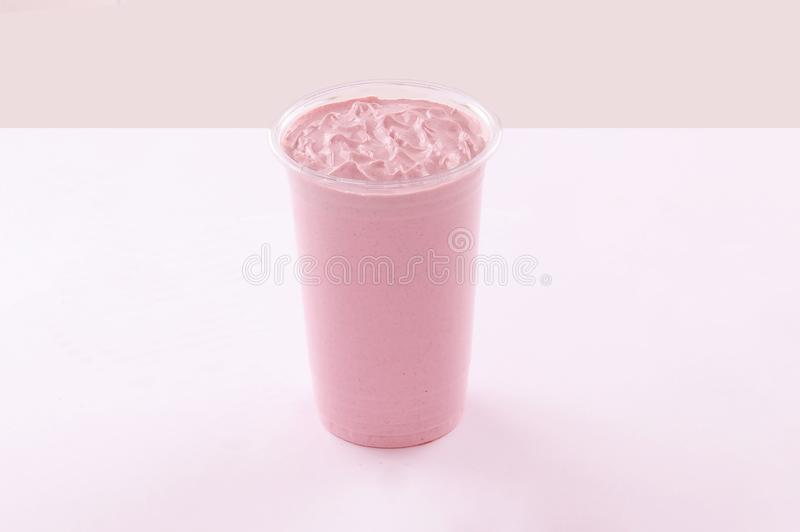 Strawberry milkshake in plastic cup white background stock images