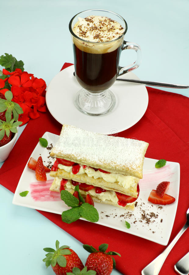 Strawberry Mille Feuille. Delicious strawberry mille feuille with fresh strawberries and Vienna coffee royalty free stock photos
