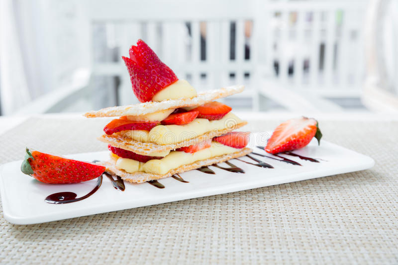 Strawberry Mille Feuille. Cake in white plate royalty free stock photo