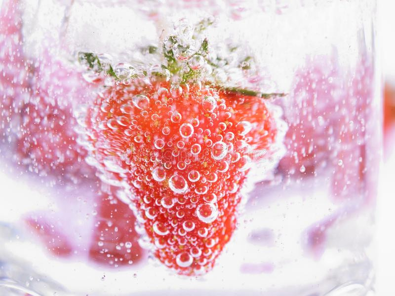Strawberry in Mineral water with boobles stock image