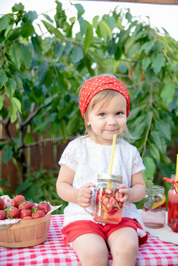 Strawberry and mint infused detox water. strawberry lemonade with ice and mint as summer refreshing drink in jars. Cold soft. Lemonade Stand. Adorable little stock photos