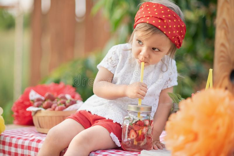 Strawberry and mint infused detox water. strawberry lemonade with ice and mint as summer refreshing drink in jars. Cold soft. Lemonade Stand. Adorable little stock photo