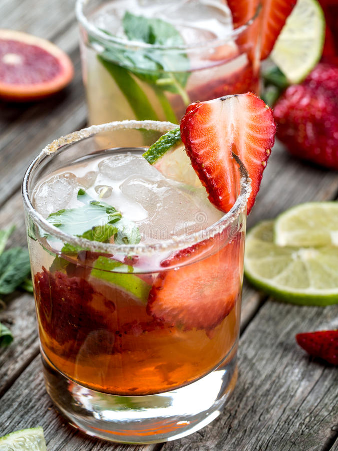 Strawberry mojito cocktail. On a wooden table royalty free stock photo