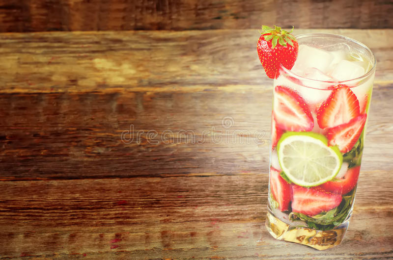 Strawberry mojito. On the dark wood background. toning. selective focus on strawberry royalty free stock photos