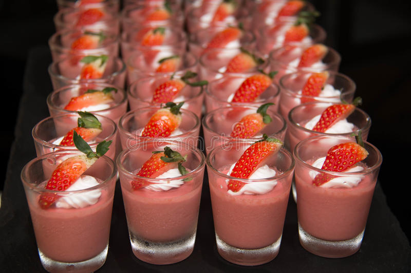 Strawberry panacotta cream dessert on the table royalty free stock photo