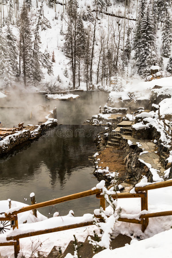 Strawberry Park Hot Springs. Strawberry Park Hot Spings natural hot springs in winter after freshly fallen snow stock images