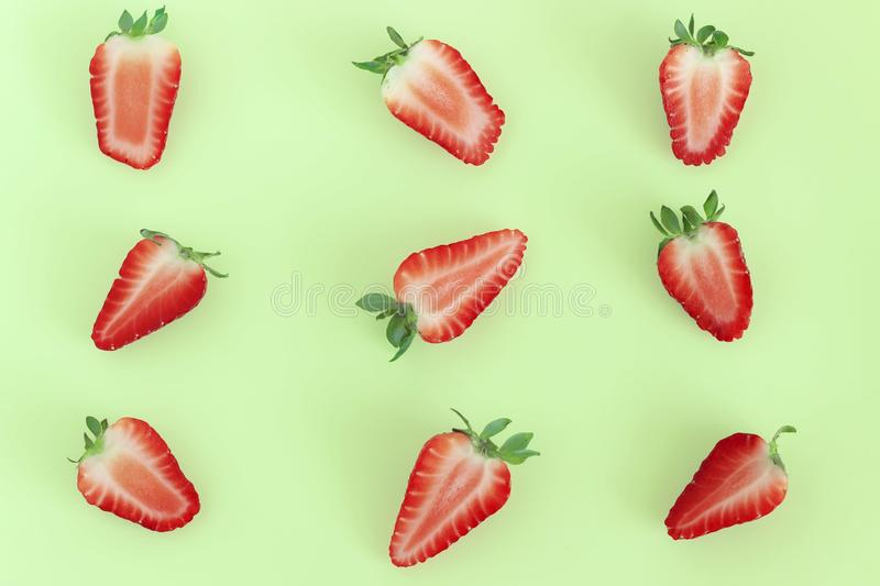 Strawberry pattern on green background, Summer concept. Flat lay, top view, square. Color creative food fruit healthy red sweet abstract fresh half juicy layout stock photos