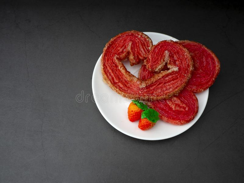 Strawberry puff heart-shaped on granite board royalty free stock image