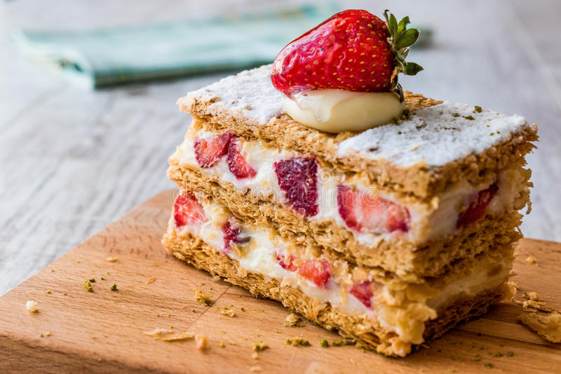 Strawberry puff mille-feuille with strawberry. Fruity Dessert stock image