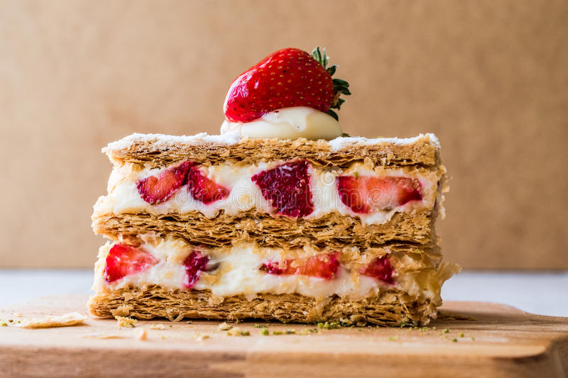 Strawberry puff mille-feuille with strawberry. Fruity Dessert royalty free stock images