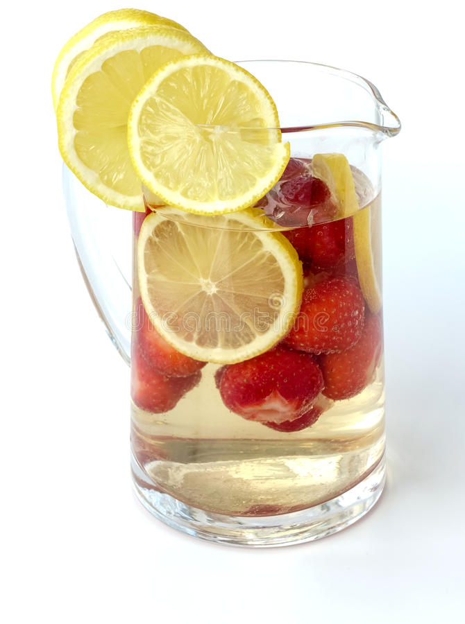 Strawberry Punch in a Glass Jug isolated on White Background stock images