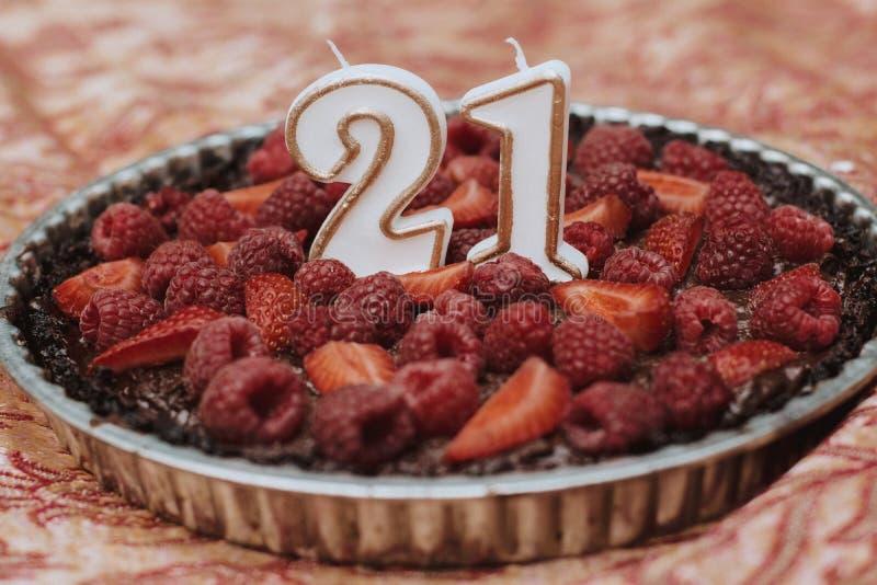 Strawberry raspberry tart 21st birthady candles stock photo