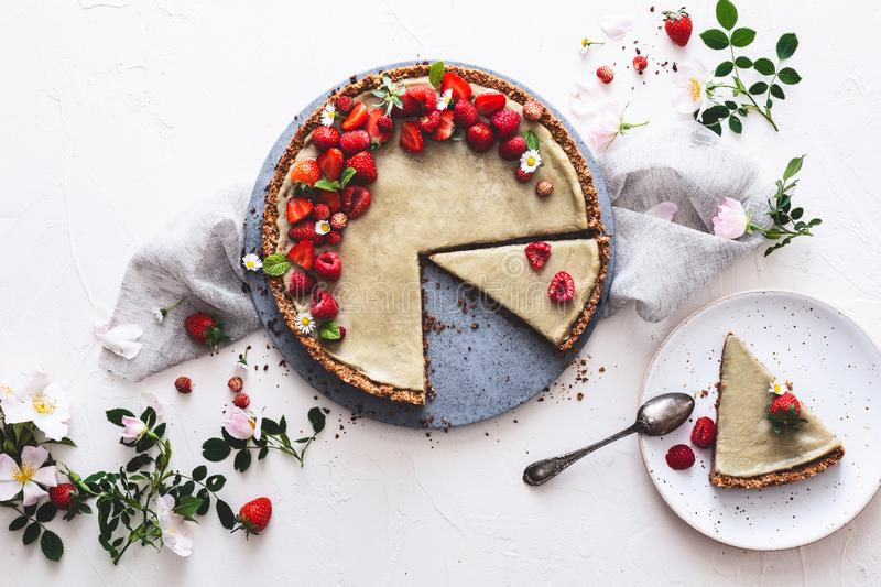 Strawberry and Red Fruits Tart with Coconut and Chamomille cream. Vegan Dessert. On wooden background stock photography