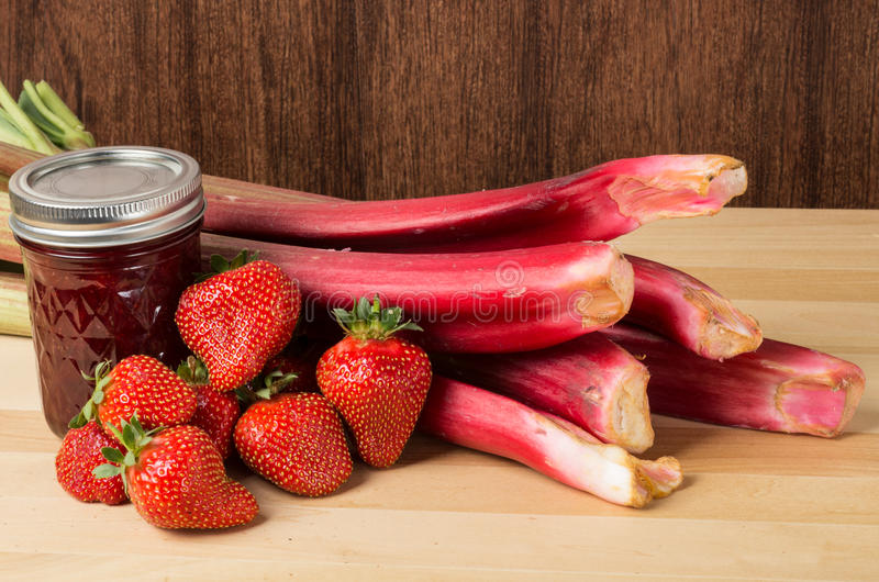 Strawberry rhubarb jam with berries and rhubarb stock photography