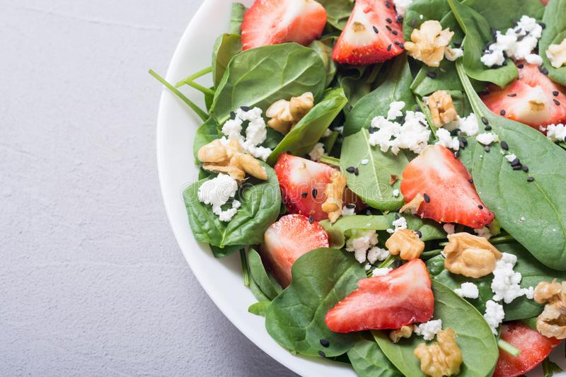 Strawberry salad with spinach cheese and walnut . Healthy food. Strawberry salad with spinach , cheese and walnut . Healthy food stock images