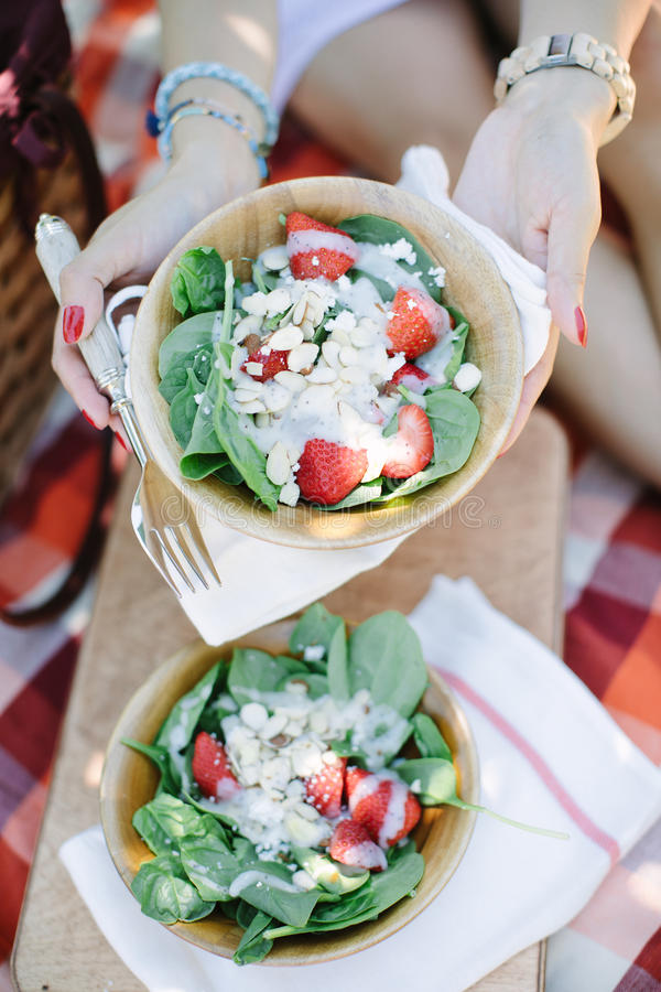 Strawberry salad in wood bowl picnic stock photo