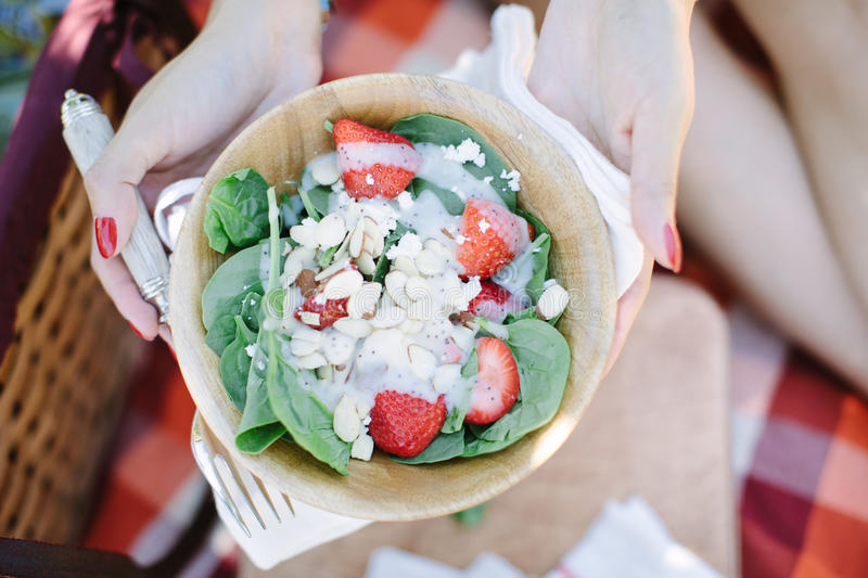 Strawberry salad in wood bowl picnic stock images