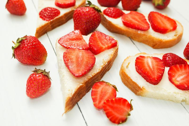 Strawberry sandwiches for breakfast. Diet and a healthy lifestyle. Vegetarian stock photography