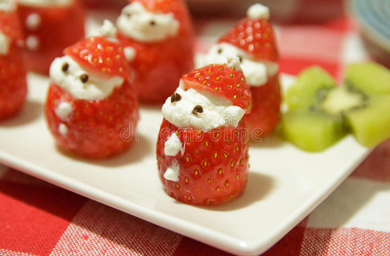 strawberry Santa Claus stock photos