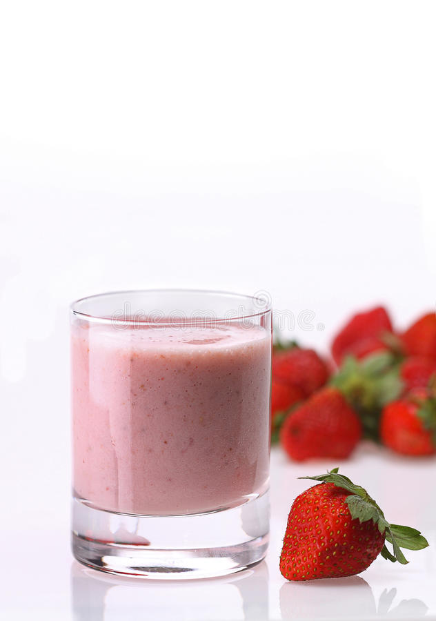 Strawberry shake. In glass on white stock photography