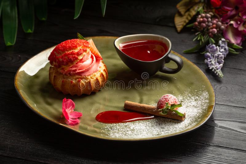 Strawberry shu with sweet sau e on a wooden background stock photo