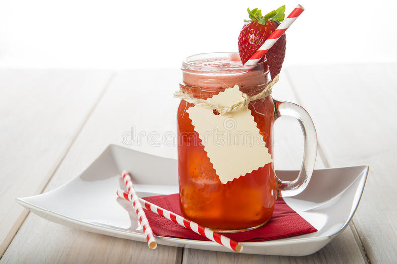 Strawberry smoothie in a glass jar royalty free stock image