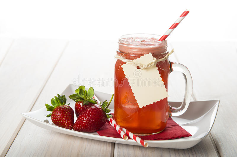 Strawberry smoothie in a glass jar stock photography
