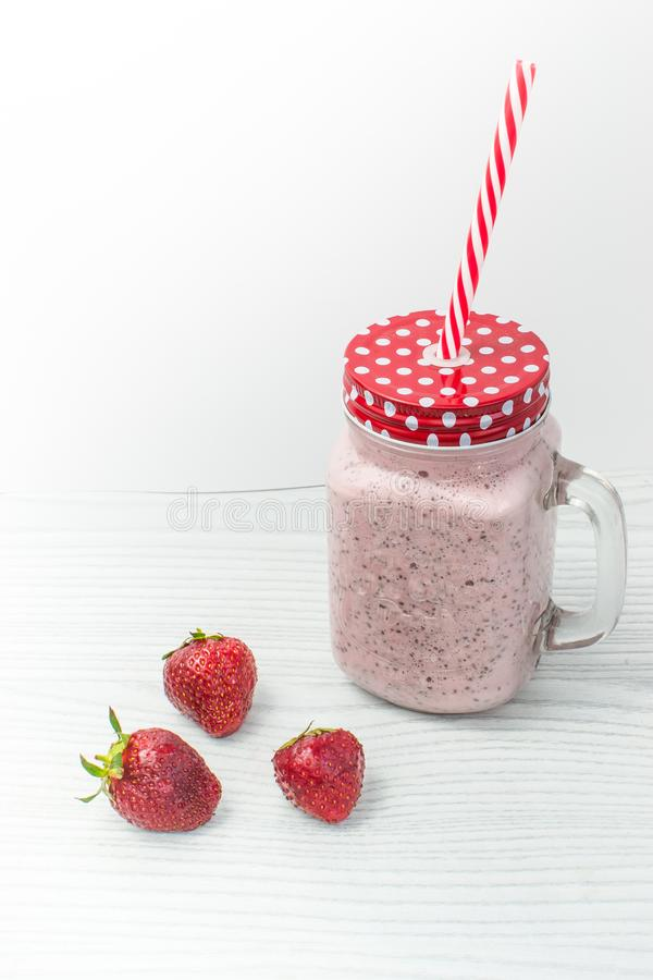 Strawberry smoothie in jar with handle royalty free stock photo