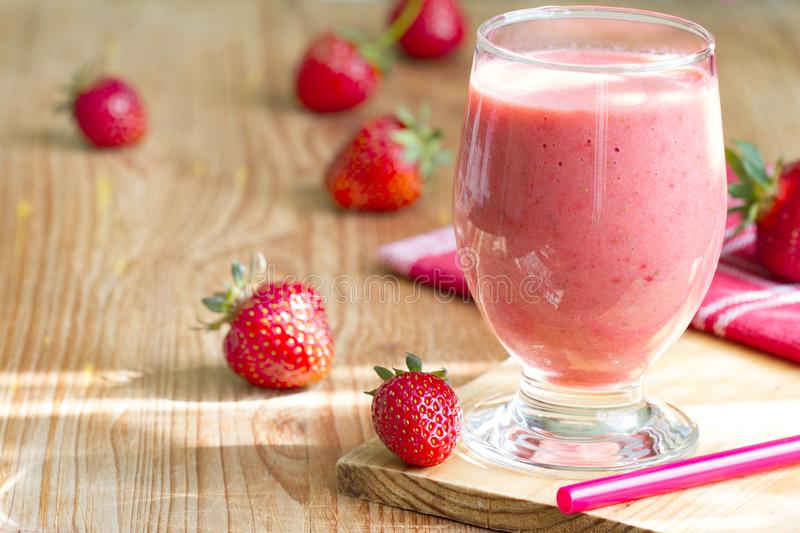 Strawberry smoothie with raw fresh berry on sun. Still life royalty free stock photography