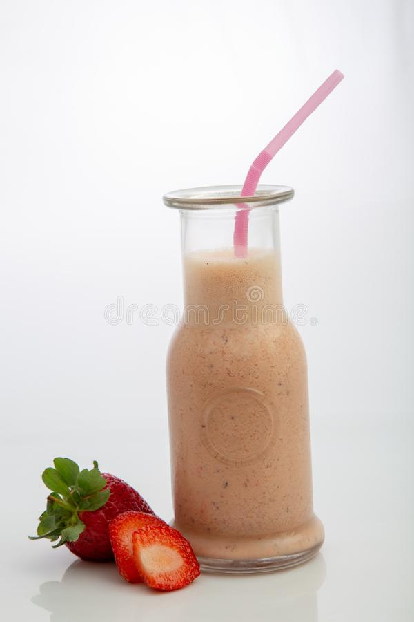 Strawberry smoothie in white background stock image
