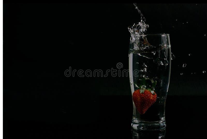 Strawberry splash. royalty free stock photography
