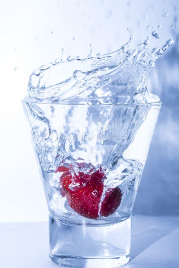 Strawberry splash royalty free stock photos