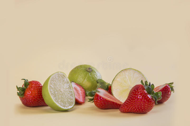 A Strawberry split into two stock images