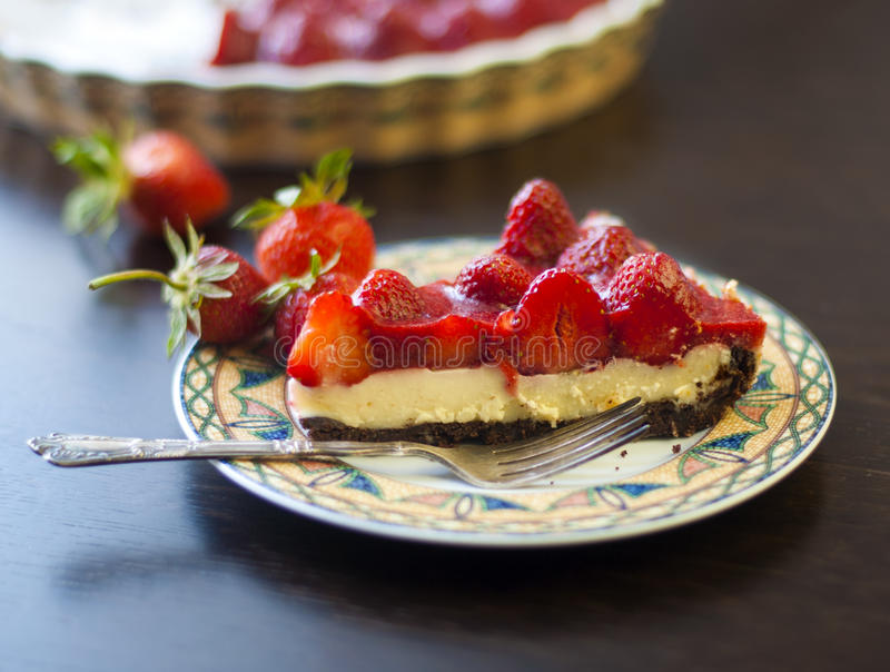 Strawberry tart with cream filling. On a table royalty free stock photography