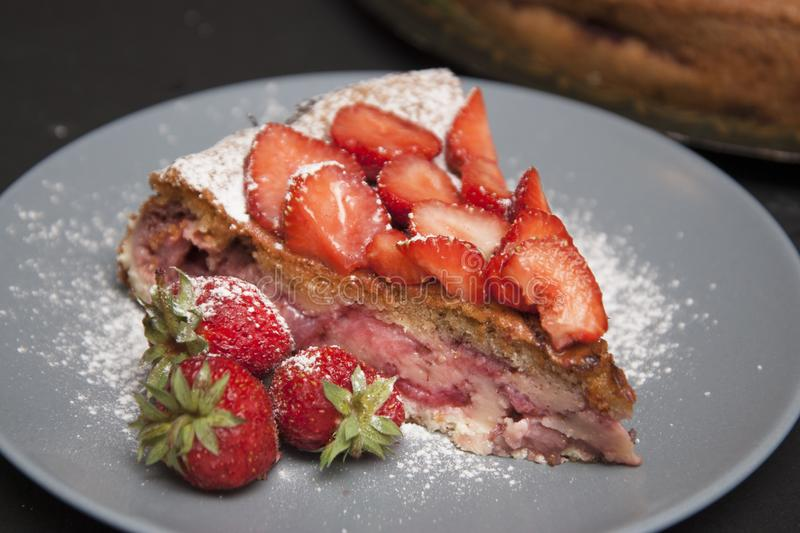 Strawberry Tart Piece. homemade Fruit Berry Cake Tart Pie with Strawberries. Black Board. stock image
