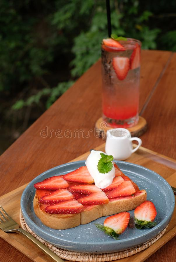 Strawberry toast with iced strawberry soda stock photography